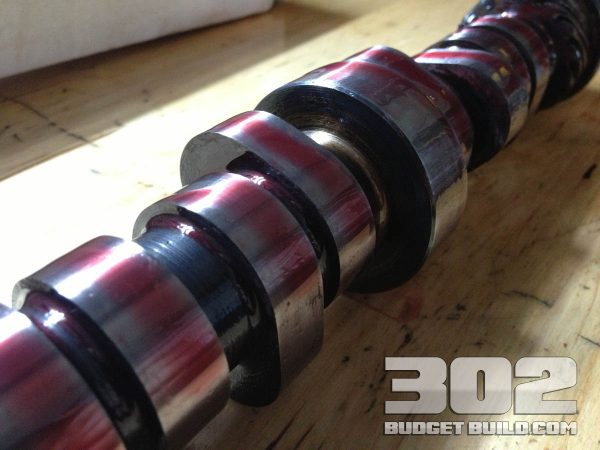Ford racing camshaft E303. Closeup of cam lobes with assembly lube