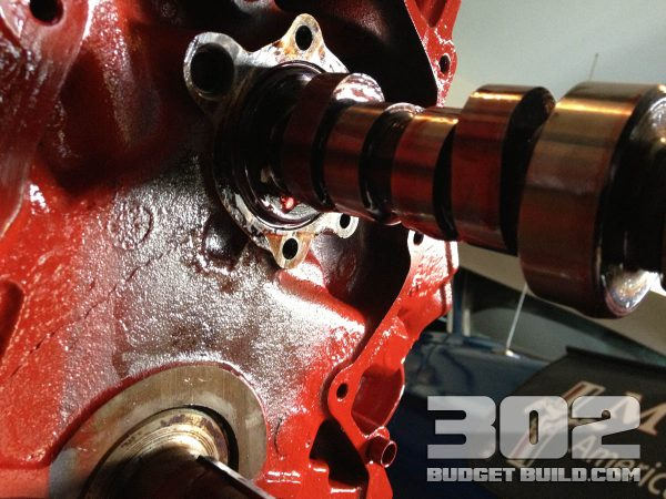 A helper screw is threaded into the camshaft to allow for manipulation over the cam bearings. The longer the bolt, the better