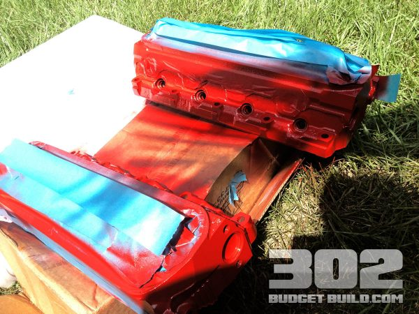 Here are the gt40p heads after the first coat of paint. Looking red and new again.