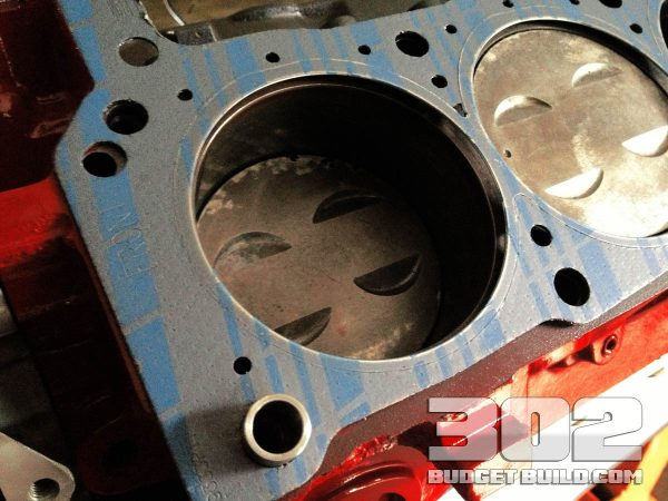 This is the head gasket properly installed on the engine block. Notice how the gasket is aligned on the dowels.