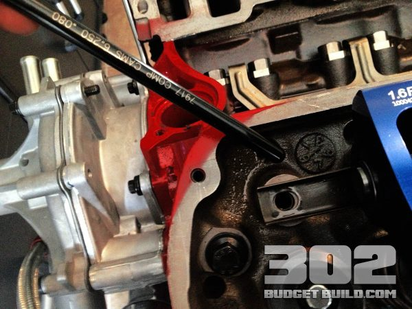 Install a pushrod at base circle of the lifter position on camshaft.