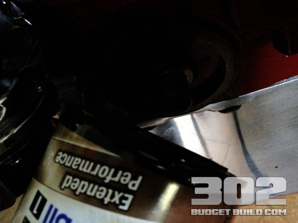 Install a new Mobil 1 oil filter or oil filter of your choice after the adapter is installed